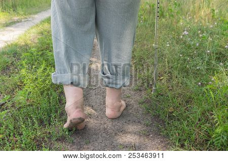 Man Walking On An Earth Road Barefoot