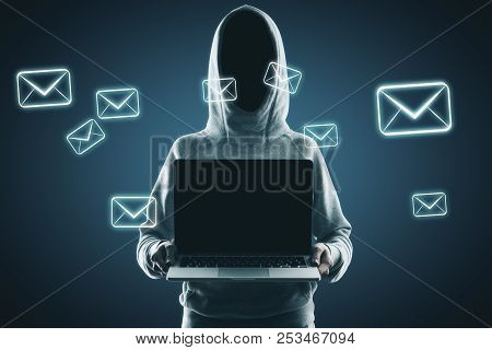 Hacker Holding Empty Laptop With Digital Emails On Blue Background. Email And Thief Concept