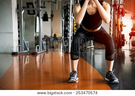 Fitness Woman Doing Squat Workout For Fat Burning And Legs Strength In Fitness Sports Gym With Sport