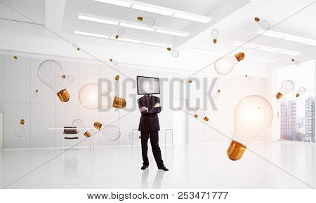 Businessman In Suit With Tv Instead Of Head Keeping Arms Crossed While Standing Among Flying And Glo