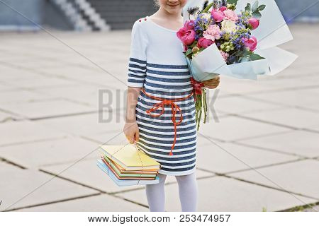 A Bouquet For The First Beloved Teacher On The First Of September. Flowers For The Last Bell. Day Of