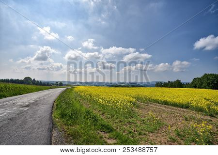 Beautiful Landscape With Fields And Mountains In Summer