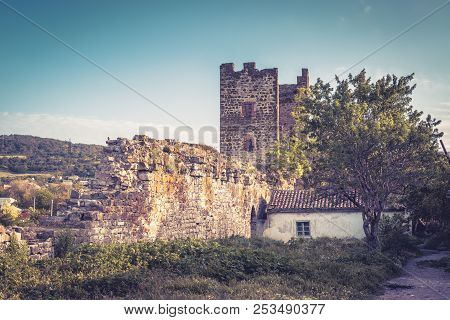 Ancient Genoese Fortress In Feodosia, Crimea, Russia. Picturesque View Of The Medieval Ruins With Ol
