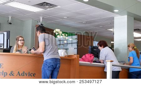 Coquitlam, BC, Canada - May 14, 2018 : Motion of people talking to the teler at service counter inside TD bank