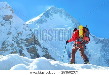 Climber Reache The Summit Of Mountain Peak. Climber On The Glacier. Success, Freedom And Happiness,