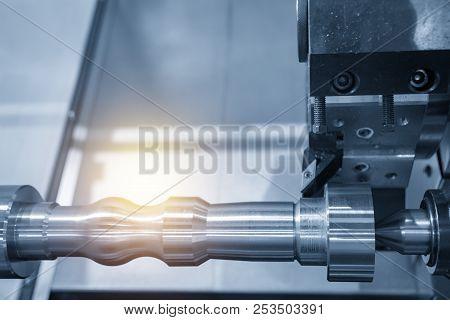 The Cnc Lathe Machine Or Turning Machine Cutting The Aluminum Rod . Hi-technology Manufacturing Proc