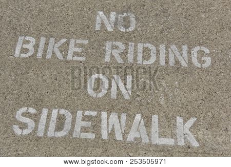 Sidewalk Warning Of No Bike Riding In Community