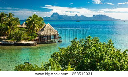 Overwater bungalows with best beach for snorkeling, Tahiti, French Polynesia, Moorea in the background