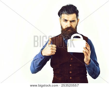 Hipster With Moustache Holding Lunch Box With Serious Face Isolated On White Background. Bearded Man