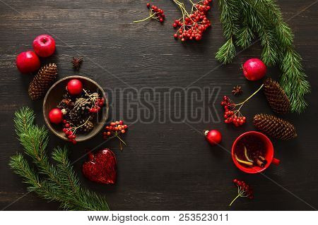 Christmas Natural Decor Stuff On Moody Rustic Table Top Ready For Setting A Dinner Table, Cup Of Win