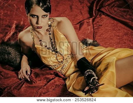 Retro Look And Pinup. Girl In Yellow Dress And Fur With Mouthpiece. Woman With Stylish Retro Hair, M
