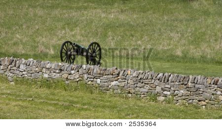 Canon And Stone Wall