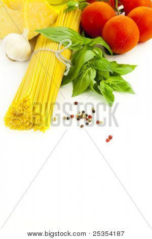 Ingredients for Italian cooking: basil, tomato, parmesan, garlic and spaghetti /  isolated on white