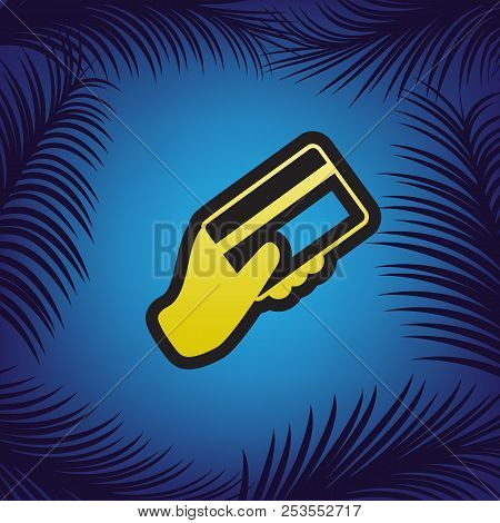 Hand holding a credit card. Vector. Golden icon with black conto poster