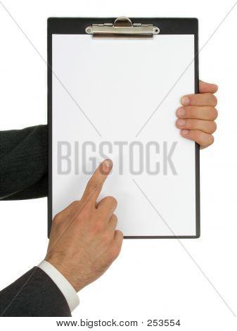 Businessman's Hands Holding Clipboard