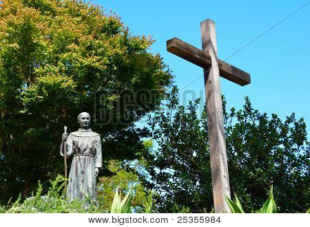 Priest And Cross Statue