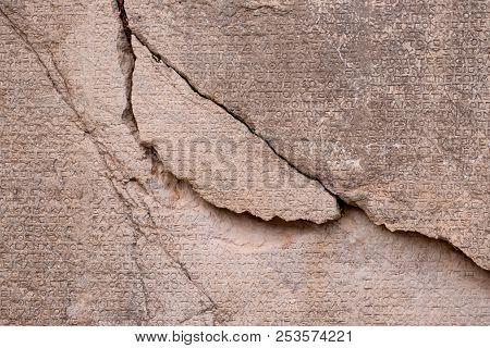 Ancient Greek Writing Chiseled On Stone At Turkey