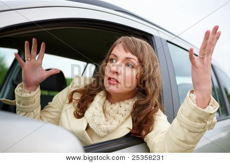 Angry young woman stuck in a traffic jam poster