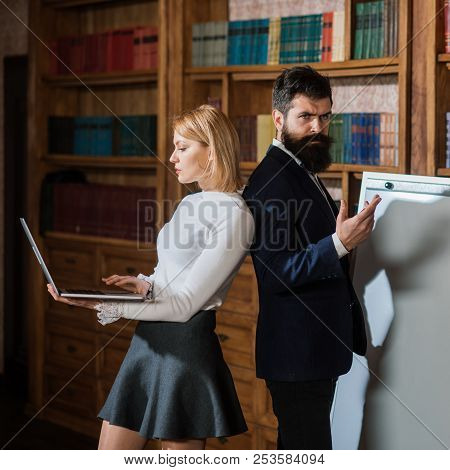Computer Concept. Woman And Man Develop New Project Using Computer. University Students Surfing Inte