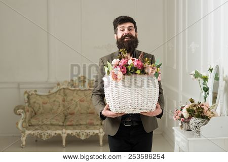 Fresh Concept. Bearded Man Hold Basket With Fresh Flowers. Man Smile With Fresh Floral Arrangement.