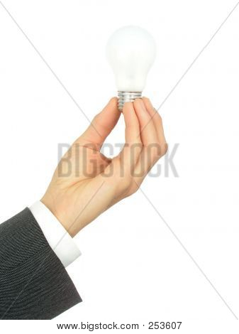 Businessman's Hand Holding A Light Bulb