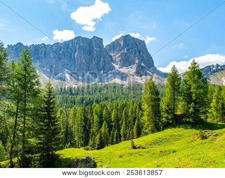 Lastoni De Formin, Aka Ponta Lastoi De Formin. Giant Mountain Block With Green Meadow, Trees And Sum