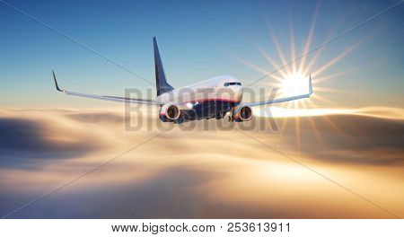 Passenger Airplane. Landscape With Big White Airplane Is Flying In The Red Sky Over The Clouds And S