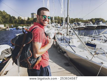 Young Happy Smiling Man In Glasses In Yacht Club. Guy In Red Shirt. Businessman In Sunglasses. Hands