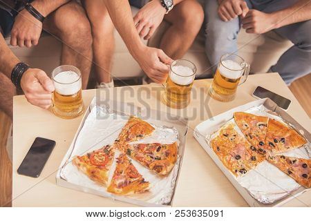 Top View. Boxes With Pizza And Glasses With Beer. Friends On Party. Weekend At Home. Three Happy Fri