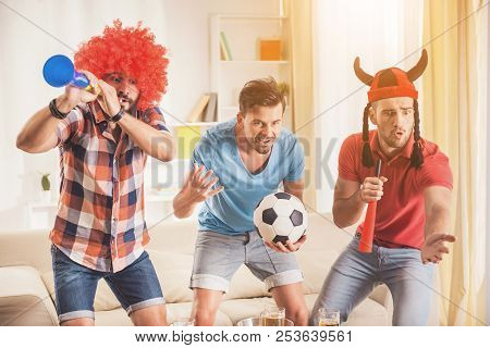 Three Friends Rooting For Footbal Team At Home. Friends On Party. Weekend At Home. Three Happy Frien