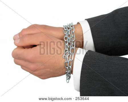 Businessman's Hands In Chains