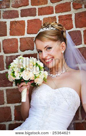 Happy Bride With Wedding Bouquet