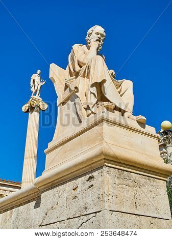 Athens, Greece - June 30, 2018. Statue Of Socrates At Principal Facade Of The Academy Of Athens, Gre