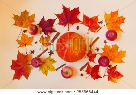 Colorful Autumn Pattern Made Of Pumpkin, Apples And Maple Leaves. Fall Concept.