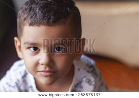 Young Caucasian Boy Looking With A Serious Attitude. Copy Space.