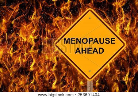 Menopause Ahead Caution Sign With Flaming Background