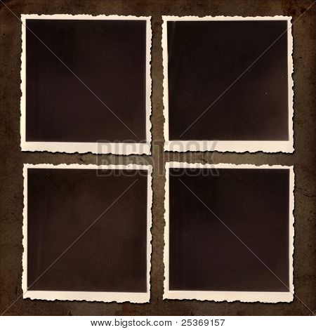 Blank old photographs on a grungy paper background