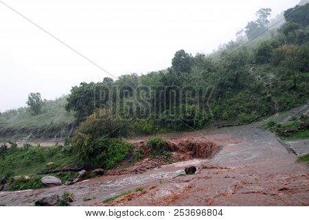A Huge Rainstorm Creating Mudslides And Puddles