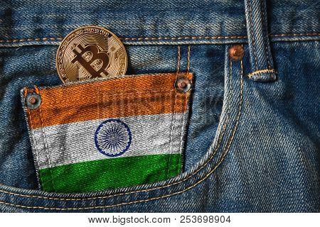 Golden Bitcoin (btc) Cryptocurrency In The Pocket Of Jeans With The Flag Of Republic Of India On Jea