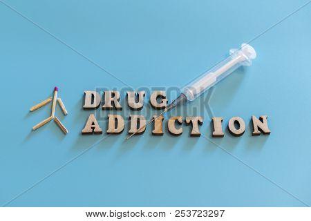 Drug Addiction Concept. Human Figure, Drugs, Drug Addiction On A Blue Background