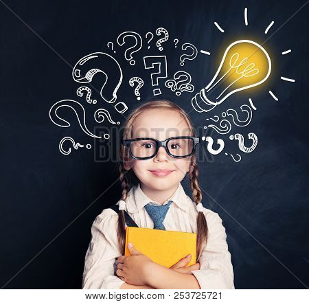 Child Ideas. Smiling Child School Student With Yellow Book, Lightbulb And Chalk Question Marks. Brai