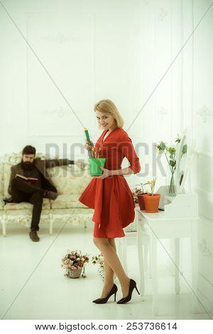 Floral Concept. Woman Planting Flower In Pot, Floral Decor. Woman Work On Floral Arrangement While M