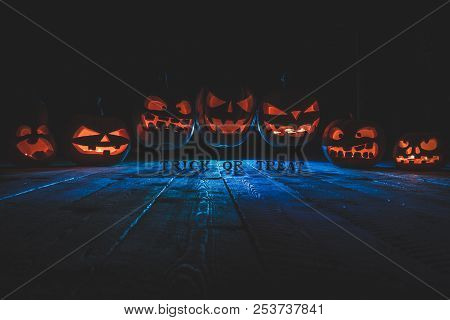 Concept Of Halloween. Many Glowing Fiery Light Of Evil Scary Pumpkins Flying Through The Air. Jack L