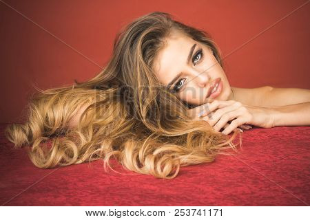 Beautiful long hair. Beautiful model girl with shiny long hair. Haircare products. Lifestyle&cosmetics concept. Beauty woman with luxurious long hair and bright makeup. Healthy hair. Hairstyle&make-up poster