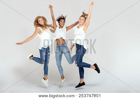 Group Of Smiling Girls Having Fun Together.