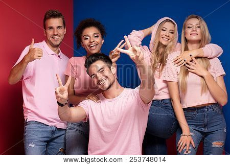 Group Of Smiling People Having Fun Together.