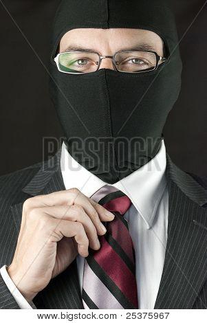 Businessman In Balaclava Straightens Tie