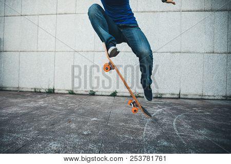 One Young Skateboarder Legs Skateboarding On City