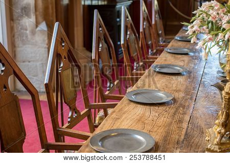 Medieval Dining Table And Chairs. Mediaeval Period Banquet Table Set With Metal Plates. Fine Histori