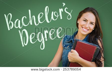 Bachelors Degree Written On Chalk Board Behind Mixed Race Young Girl Student Holding Books.